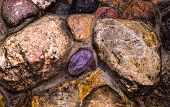 Decorative Wall Of Large Stones. Concreted Stones. Pebbles In The Wall. A Garden Wall. Decorative Su poster