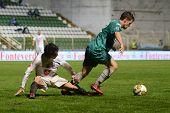 KAPOSVAR, HUNGARY - JULY 30: Bojan Pavlovic (in green) in action at a Hungarian National Championship soccer game - Kaposvar (green) vs Videoton (white) on July 30, 2011 in Kaposvar, Hungary.
