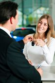 pic of rep  - Woman at a car dealership buying an auto - JPG