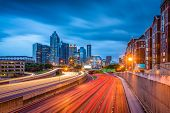 Atlanta, Georgia, USA downtown skyline and highway at dusk. poster