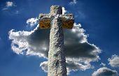 Stone Cross Against Cloudy Sky