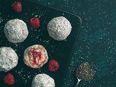 Raw Vegan Lamington Bliss Balls With Raspberries Chia Jam On Dark Background. No Baked Healthy Vegan poster