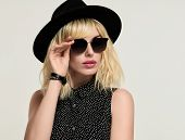 Portrait Blonde Girl In Elegant Dress And Trendy Black Hat, Sunglasses. Fashion Young Woman In Styli poster