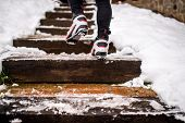 Feet Of Unrecognizable Cross-country Skier, Walking Up The Stairs. Winter Time. poster