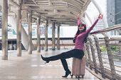 Happy Woman Traveller At Airport Walkway poster