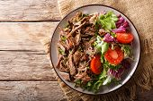 Delicious Food: Slow Cooked Pulled Beef With Fresh Vegetable Salad Close-up. Horizontal Top View Fro poster