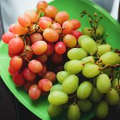 Bunches Of Red And Green Grapes On A Plate For Healthy Vitamin Nutrition poster