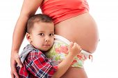 pic of pregnant woman  - Pregnant woman and a little kid boy - JPG