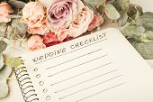 Wedding Checklist With Copy Space And Rose Bouquet On The White Desktop. Marriage Planner Concept, C poster