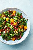 Hokkaido pumpkin and quinoa salad with kale, pomegranate, spring onion and toasted sunflower seeds.  poster