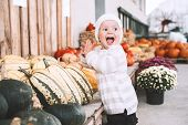 Child Picking Pumpkins At Pumpkin Patch. poster