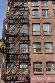 Fire Staircase On A Historic Red Brick Building
