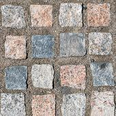 Top View On Stone Road Close Up. Abstract Background Of Cobblestone Pavement Close-up. The Pavement  poster