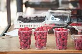 Raspberry, Fresh And Red, For Sale On A Market In Belgrade, Serbia Piled On A Stall. These Are Among poster