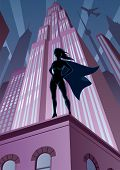 stock photo of superwoman  - Super heroine watching over the city. 