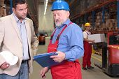 Manager And Experienced Worker In Warehouse