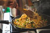 The Pictures Of The Kitchen Cooking Thai Food. Pad Thai Is The National Food Of Thailand, Sold In Th poster