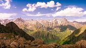 Bright Panoramic View Of The Mountain Range At Sunrise. Toned poster