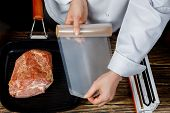 The Chef Measures The Vacuum Pack For Packing Meat. poster