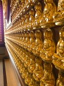 Rows Of Golden Buddha Statue On The Wall In Nonthaburi Thailand, Buddha Pattern poster