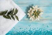 Spa And Wellness Setting With Flowers, And White Towel On Old Wooden Background. Blue Dayspa Nature  poster