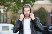 Hooded And Protected. Handsome Man Unshaven Face And Stylish Hair. Caucasian Man Urban Background. B poster