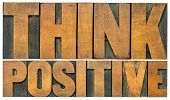 Think positive -isolated  word abstract in vintage letterpress wood type blocks, optimism and mindse poster