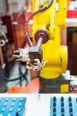 Automation system control application on automate robot arm in smart manufacturing background. poster