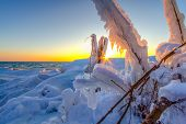 Ice Formations On The Coast Of Lake Michigan. Beautiful Sunset On The Coast Of Lake Michigan With Ic poster