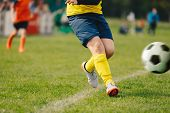 Shoot Of Football Player On The Outdoor Field. Junior Soccer Match. Football Game For Youth Players. poster