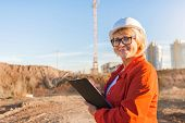 Woman Architect On Building Construction. A Middle-aged Woman Is An Inspector On The Site, Mature Wo poster