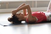 Calm Woman Lying On Mat Relaxing After Training At Home poster