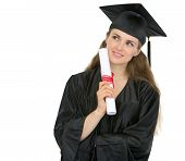 image of thoughtfulness  - Thoughtful graduation woman with diploma looking on copy space - JPG