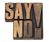 say no exclamation - time management or fighting violence concept isolated text in vintage letterpress wood type