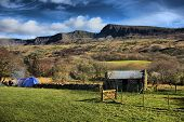 Old stone barn in front of Cadair Idris
