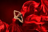 Woman In Red Dress Blowing With Beautiful Flying Fabric