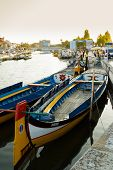 Traditional Moliceiro Boats In The Canal Of Aveiro City, In Portugal