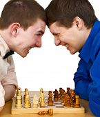Two Aggressive Chess Opponents Under Chess Board