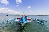 Outrigger boat moored at wharf, Palawan, Philippines