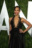 WEST HOLLYWOOD, CA - FEB 24: Zoe Saldana at the Vanity Fair Oscar Party at Sunset Tower on February