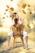 Beautiful Woman Sitting In Autumn Field