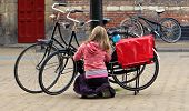 Blonde Girl Locking Bicycle
