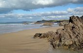 Newquay sandy beach rocks, Cornwall UK.