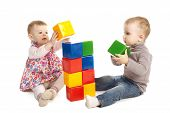 boy and girl playing with cubes