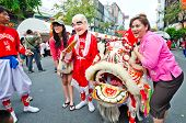 Unidentified People Celebrate With Chinese Lion