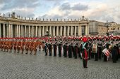 VATICAN - APRIL 19: Pontifical Swiss guards and military band stand on Saint Peter's Square during new pontific elections in Vatican city, Vatican on April 19, 2005.