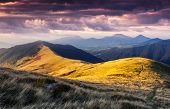 Majestic mountains landscape under morning sky with clouds. Overcast sky before storm. Carpathian, U