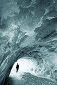 Man walking out of an ice cave