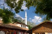 the Ottoman Bazaar in Kruja and the white minaret against blue sky