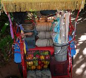 pic of nick-nack  - A colorful Bicysle cart with fruit and other nick nacks - JPG